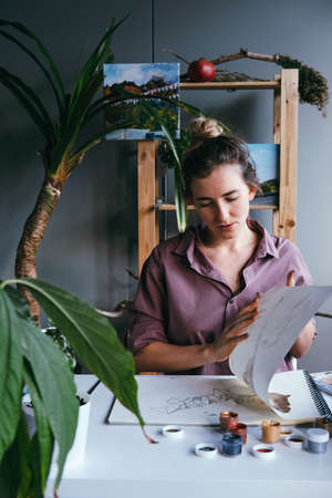 Woman working at modern work place in art studio