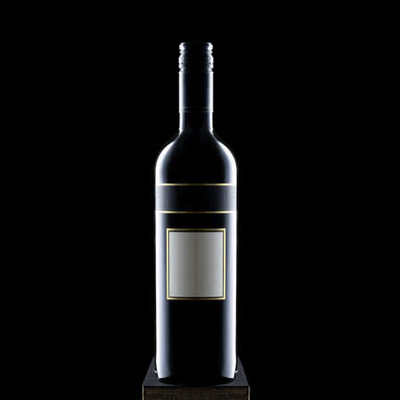 Black wine glass bottle on a black background copy space selective focus, blank mock up label Stock Photo