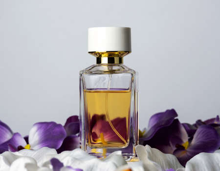 Perfume bottle and orchid gray background