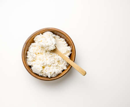 Top view cottage cheese wooden bowl white background