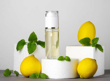Jars of perfume, lemons and mint leaves. Beauty concept, modern still life.