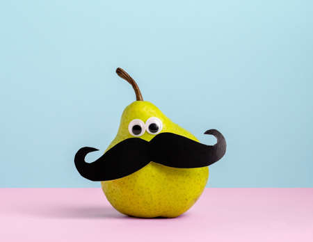 Cute card pear with googly eyes and mustache pink blue background.