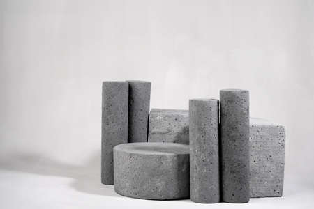 Concrete empty podiums on a gray background. Mock up product stands.