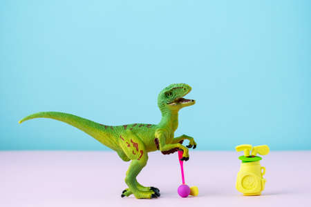 Cute little dinosaur playing golf. Humor card for the day of golf lovers. Stock fotó