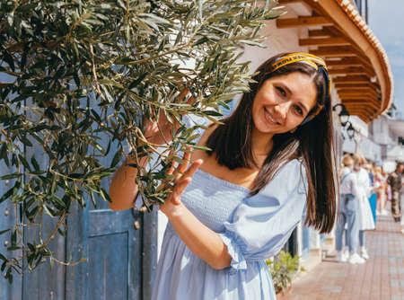 Positive summer lifestyle caucasian woman portrait wearing blue dress