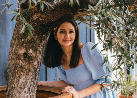 Positive summer portrait caucasian woman wearing blue dress Stock fotó