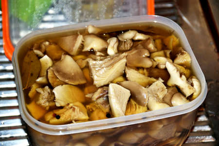 Preparation of the pickled mushrooms on the kitchen
