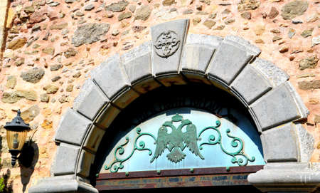 Stone arch with a double-headed eagle on the door of the old Church, the Island of Crete, Greece