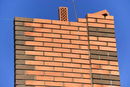 Masonry-brick walls on a building site, construction of cottages Stock Photo