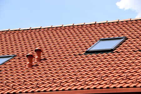Pattern of red ceramic roof shingles and Windows