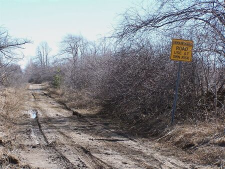 mud and snow: Unmaintained Road Stock Photo