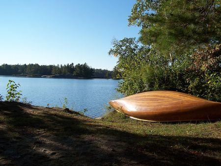 Cedar strip canoe beside lake
