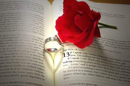 1: Rings and Rose on Bible Stock Photo