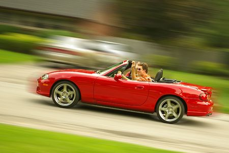 Red sports car with motion blur background