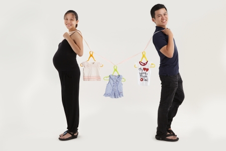 A cheerful parent is expecting their first children photo