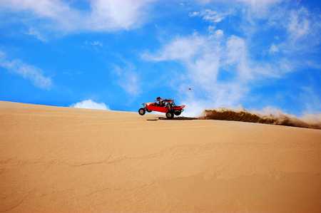 Orange Dune Buggy Doing Wheely On Dune