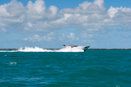 white speed boat cruising in the florida keys