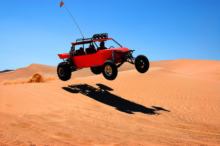 dunebuggy jumping on sand dune in death valley california Stok Fotoğraf
