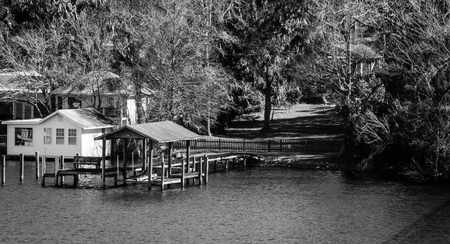 black and white image of home located on the ortega river in jacksonville florida