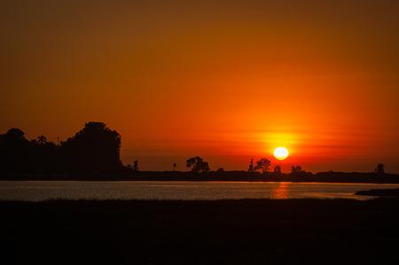 deep orange sunset shot over the lagoon at the carlsbad california estuary