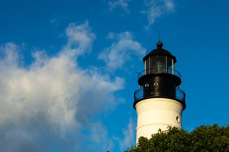 antique light house with clouds in sky in key west florida