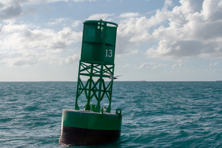 number 13 green navigation bouy in key west harbor Фото со стока