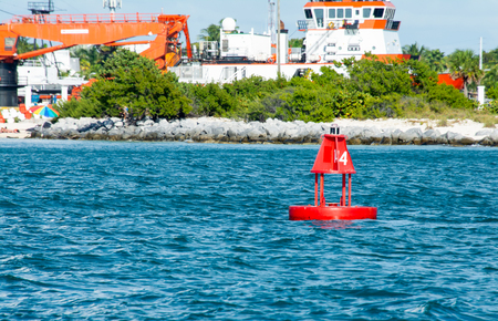 number 4 red navigation bouy with key west skyline in background