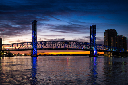 main street bridge in jacksonville florida with sunrise in background