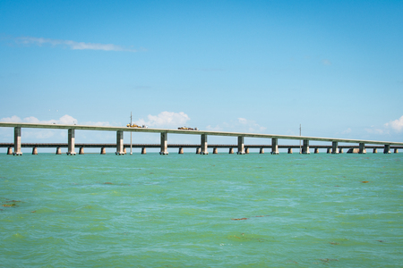 horizontal view of the seven mile bridge on the way to key west shot from the water