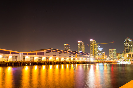dramatic night time long exposure of the city skyline of the san diego working harbor Фото со стока