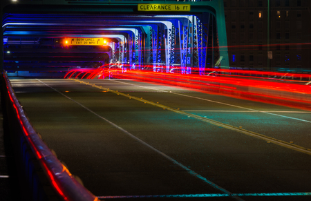 Light Trail From Cars Going Over Main Street Bridge Stock Photo