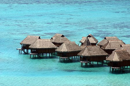 Huts over the water in Tahiti photo