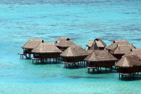 bora: Huts over the water in Tahiti