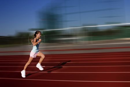 girl running at track photo