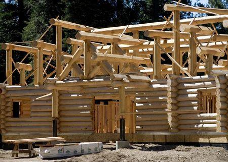 Constructing a log cabin photo