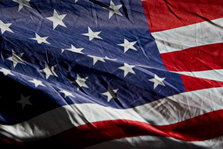 faded: Old American Flag in the wind Stock Photo