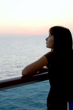young girl gazing at sunset Stock Photo