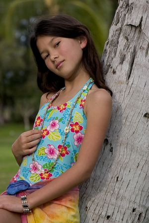 suite: young girl in bathing suite leaning on tree
