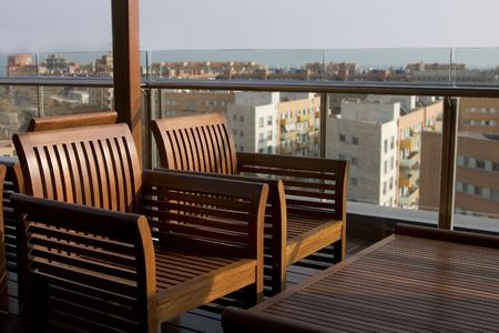 deck chairs at an outside bar on top of a hotel