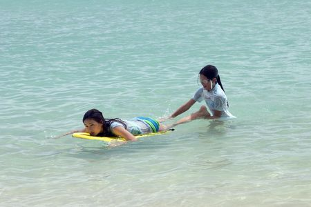 girls playing in the ocean photo