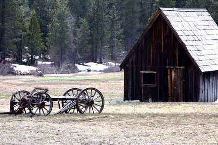 old wooden wagon in a field in front of a barn Stock Photo - 7040517