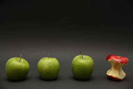 exception: A line of apples with one exception.