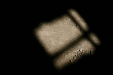 An abstract photo of light shining through the window, on the ground. It has quite a lonely, sad, atmosphere to it. Stock Photo - 801508