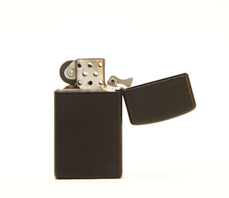naphtha: A black, open lighter on a white background. Stock Photo