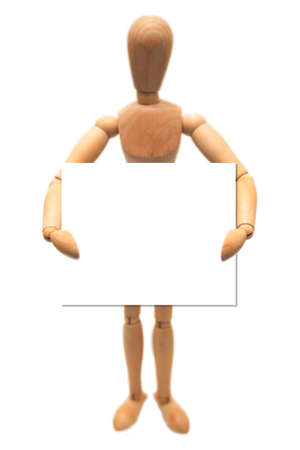 A wooden dummy, holding a white card, isolated on white.