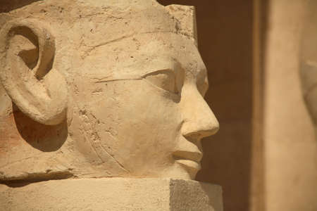 sculp: A large stone egyptian statue outside the Hatshepsut Temple in Luxor. Stock Photo