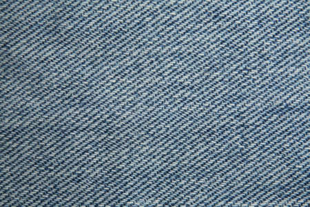 A close up photo of the jeans texture.