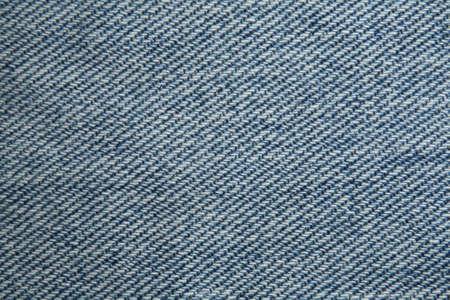 Una fine sulla foto della struttura dei jeans. Archivio Fotografico