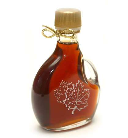 A small bottle of maple syrup with the maple leaves printed on the front and a nice golden ribbon on the neck!