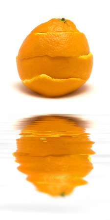 peal: An orange peal being healed.   (with water reflection) Stock Photo